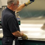 Ken Inspecting a Sheet of Aluminum